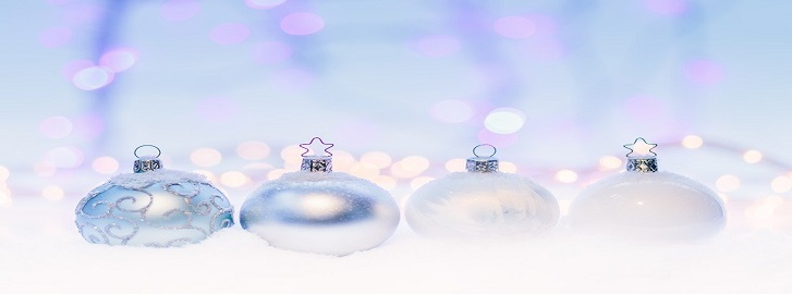 glass ornaments lined in the snow